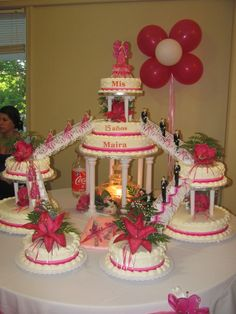 Quinceanera Cake. I guess it should say Cakes - what a great idea with stairs and Chambelanes and Damas.
