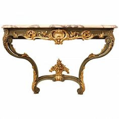 An attractive 19th century French Louis XV st. patinated green and giltwood console. The console is raised by two 'S' scrolled legs with richly carved acanthus leaves at the base, joined by a stretcher centered by a carved basket of floral garlands. The scalloped frieze has a pierced central reserve of an acanthus leaf amidst scrolls. All below the serpentine shaped Brèche Violette marble top.