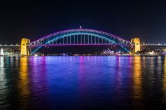 The Sydney Harbour Bridge, Australia illuminated with 100,000 individually programmed low-energy painting it in a fantastic array of colours, movements and effects. #vividsydney