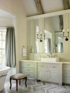 Luxurious, Traditional Bathroom With Herringbone Tile Floor