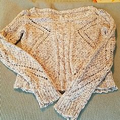 American Eagle sweater american eagle sweater. Tan colored and slightly cropped. Perfect to bring on a summer night for a beach bonfire! Looks so good with jean shorts over your bikini! So cute- need need need. American Eagle Outfitters Sweaters