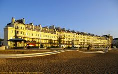 "Panorama of Dover Marina Hotel and Spa from the Beach at Sunrise, Waterloo Crescent, Kent, England. Victorian Waterloo Crescent Grade II Listed Building. Marine Parade. West: DHB's ""Harbour House"". Centre: Dover Marina Hotel, ex-Churchill Hotel, White Cliffs Hotel (Eisenhower), ex-Shalimar Hotel right. East: Royal Cinque Ports Yacht Club. Architecture, Travel and Tourism. More information at http://www.panoramio.com/photo/58722961"