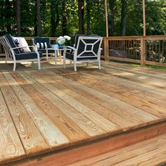 This pressure-treated deck includes copper pickets and posts for string lights. Designed and built by Atlanta Decking & Fence. Decking Fence, Fencing Companies, Decking Material, Deck Design, String Lights, Natural Wood, Atlanta, Copper, Backyard