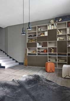 Et Cetera storage in argile with contrast 'elephant' brown lacquer fronts in a playful mix of sizes and useage