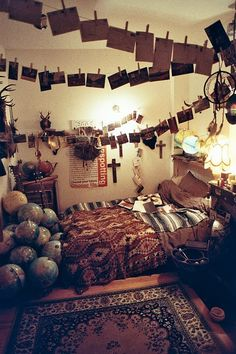i love the idea with the hanging pictures