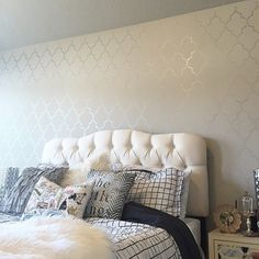 A white and silver DIY stenciled bedroom accent wall using the Marrakech Trellis Allover Stencil.   http://www.cuttingedgestencils.com/moroccan-stencil-marrakech.html?utm_source=JCG&utm_medium=Pinterest%20Comment&utm_campaign=Marrakech%20Trellis%20Allover