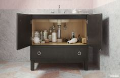 Kohler tailored vanity storage featuring an outlet in the vanity.