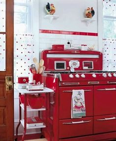 Especially love the red cart and the towel on the stove! vintage kitchen