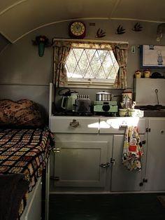 LOVE the kitchen of this Vintage caravan interior.