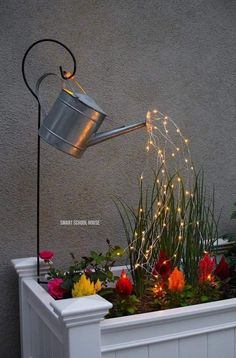 Glowing Watering Can with Fairy Lights - How neat is this? It's SO EASY to make! Hanging watering can with lights that look like it is pouring water. Hinterhof Ideen Landschaftsbau Watering Can with Lights (VIDEO) Tree Lighting, Outdoor Lighting, Outdoor Decor, Backyard Lighting, Landscape Lighting, Garden Lighting Ideas, Outside Lighting Ideas, Outdoor Candles, Party Outdoor