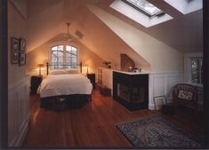 Look for traditional bedroom pictures.  Elegant master bedroom in the attic with sleeping alcove, fireplace, skylights and sitting area.