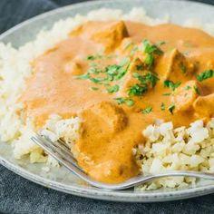 Slow cooker chicken tikka masala recipe plated with cauliflower rice