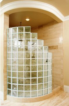 I really like this shower. I would love to know what those walls are made of. Love the glass block