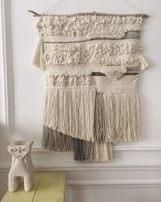 Large wallhanging handwoven with Peruvian wool, South African wool, linen, and coton rope. On a piece of driftwood. 66 cm x 96 cm (including the fringes).
