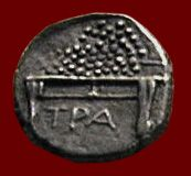 Silver drachm of the city of Trapezus on the Black Sea, c. 350-25 BCE. The coin depicts a banker's table (trapeza) piled high with coins. London, British Museum. Credits: Barbara McManus, 2001