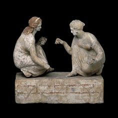 Two Etruscan girls playing knucklebones. Capua, ca..300 BCE, British Museum .wo girls playing 'knucklebones'. This game (similar to jacks) was popular amongst children and young women in ancient Greece- the players would throw the knucklebones into the air, and then try to catch as many as they could on the back of their hands. The knucklebones were made from the anklebones of sheep or goats.