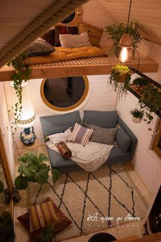 The living room has two round windows. The larger window sits above the couch area and the smaller window is up in the storage loft above the living room. wohnung fensterbank Flore by La Maison Qui Chemine - Tiny Living Room Decor Bedroom, Interior Design Living Room, Living Room Designs, Living Room Decor, Tiny Homes Interior, Modern Cabin Interior, Loft Style Bedroom, Modern Cabin Decor, Small Cabin Interiors
