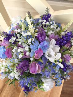 Rustic wildflower wedding bouquet in white, blue and purple. Made with artificial lavender, freesia, delphinium, forget-me-nots, gypsophila (babys breath), sweet peas, nigella and simple greenery. This bouquet is available in 3 different sizes, - bridal (10 inch), bridesmaids