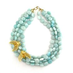Chunky aqua bead necklace.   From the bees to the color... everything about this is wonderful.