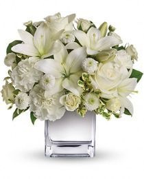 'Peace & Joy Bouquet'.  This elegant holiday bouquet includes white roses, white Asiatic lilies, white carnations and white button spray chrysanthemums.  http://www.veldkampsflowers.com/christmas/peace-and-joy-bouquet-denver-colorado