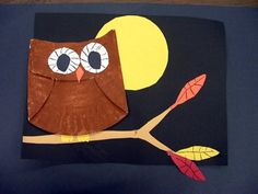 painted and folded paper plate owl collage