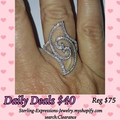 Stunning bypass swirl sterling silver ring with micro pave cubic zirconias hand-set to make this ring sparkle and shine!    Reg. $75  Clearance Close-out!