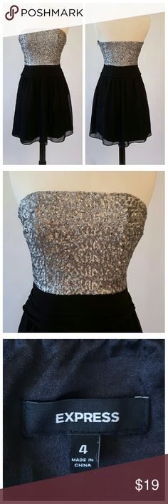 Express Strapless Dress, sequin top This dress is black with a sequined top. Sequins are silver/grey with a subtle shimmer. Express Dresses Midi