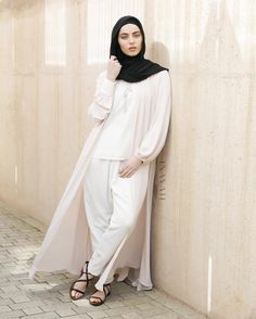 Effortless chic  Available online and in-store:  Stone Tie Neck Kimono White Tapered Trousers Black Maxi Georgette Hijab  www.inayah.co
