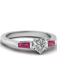 This would make an awesome engagement ring!! Heart Shaped Diamond Three Stone Ring With Pink Sapphire
