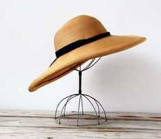 1940s Sun Hat  by Ocean Swept  I want this so bad...they don't show a size though and I'd hate to buy it only to find out it won't fit my fat head, haha