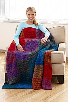 Crochet Kit: Sunset Throw (Image1).  Lion brand Homespun Yarn squares on the diagonal.