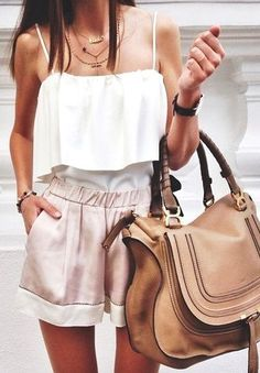 White tank top, high waisted blush pink shorts, brown leather bag