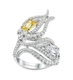 http://www.boodles.com/damask-rose-ring-317.html A spectacular ring from Boodles' iconic Wonderland collection, set with an intense yellow Ashoka diamond of 1.18ct and a white Ashoka diamond of 1.08ct, F VS1, surrounded by further round-brilliant cut diamonds in a curled petal style setting in platinum