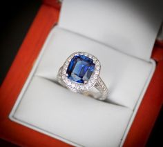 Sapphire engagement ring with diamond a halo This is the ring I want as a 10 year anniversary present!!! Love it!!