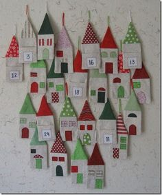When I saw the cover project from the latest issue of Quilting Arts Gifts Magazine , I knew I had to make these little houses. They are desi. Advent Calendar House, Advent House, Christmas Calendar, Christmas Countdown, Christmas Sewing, Christmas Goodies, Christmas Projects, Christmas Holidays, Christmas Decorations