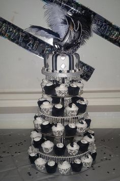 Black, white and silver Masquerade 21st birthday cake and cupcakes by eloise cupcakes, via Flickr