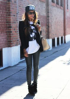 pretaportre:    Julie Sarinana [Sincerely Jules] in a BCBG blazer, tee from local shop, Paige Denim leather skinnies, Isabel Marant sneakers, New Era hat, Celine bag, Fossil watch, and Karen Walker sunnies.