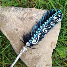 By making this purchase you are buying a made to order hand painted smudge feather with a crystal accent. I will personally chat with you