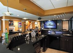 I've always wanted an awesome basement with a wrap around couch and a huge tv and a bar and a game room. ahh. dreaming.