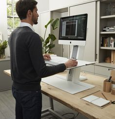 Humanscale home office ideas and inspiration, quickstand desk to create any desk of yours height-adjustable, apple computer, wooden desk, diy office stationary. Office Spaces, Home Office, Standing Work Station, Sit Stand Desk, Wooden Desk, Coworking Space, Office Ideas, Stationary, Oxford