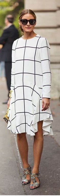 Who made Olivia Palermo's black sunglasses, sandals, clutch handbag, and white print dress