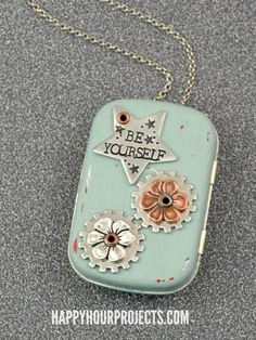 musical locket made from a mint tin