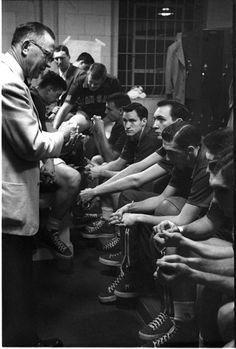 "Forrest ""Phog"" Allen gives final instructions to his team before its victory over St. John's in the 1952 NCAA National Championship game. Future North Carolina coach Dean Smith (facing camera) was a junior at Kansas. Kansas Basketball, Basketball History, Basketball Photos, Basketball Coach, Ku Bball, Championship Game, National Championship, Dean Smith, Tableaux Vivants"