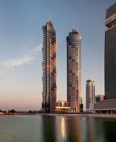 JW Marriott Marquis Hotel Dubai Tower The first of the hotel's two skyscrapers was completed in 2012 and stands at 355 metres, making it the tallest hotel in the world. #water #sunset #skyscraper