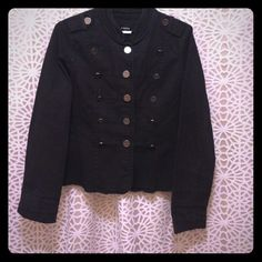 Military inspired jacket Black jacket with military inspired metal insignia buttons and tabs. Detailed seaming on front, back and arms. Mock collar. Waist length. Not quite a jean material, but close (lighter weight, more cotton?) Maurices Jackets & Coats