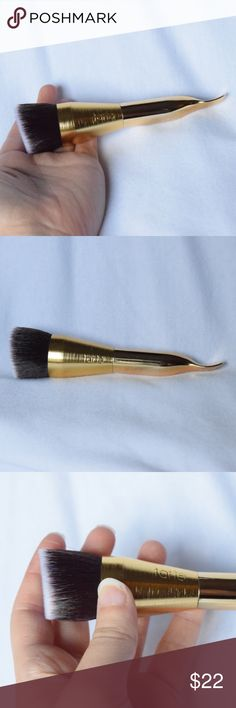 TARTE Foundation Brush In great condition! Has been washed and cleaned. There is a small spatula at the end for scooping out foundation. Make an offer if you're interested! :) tarte Makeup Brushes & Tools