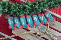 BELIEVE spelled out in 7 hand-knit Christmas stocking ornaments - sure to be a treasured heirloom in your family!  https://www.etsy.com/shop/HandmadeMaryEllen