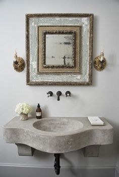 This wall mounted sink in concrete is simplistic and beautiful. The antique lamps are a beautiful touch. TLM : This wall mounted sink in concrete is simplistic and beautiful. The antique lamps are a beautiful touch. Beautiful Bathrooms, Modern Bathroom, Small Bathroom, Wall Mounted Sink, Wall Sconces, Concrete Bathroom, Concrete Sink, Concrete Lamp, Antique Lamps