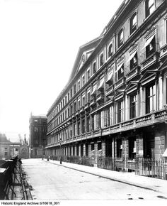 BL16618/001 A view along the grand neoclassical facade of the Adelphi Terrace, a block of 24 terraced neoclassical townhouses, built by the Adam brothers between 1768 and 1772. According to the Bedford Lemere daybook, this photograph was commissioned by an 'R Carte', which may refer to a relative of Victorian impresario Richard D'Oyly Carte, who was a resident in the Adelphi Terrace until his death in April 1901. Photographer: Henry Bedford Lemere, Bedford Lemere and Company