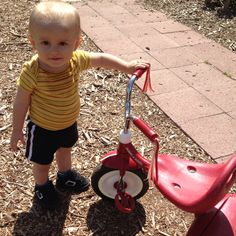My nephew Jameson hanging outside with his tricycle.